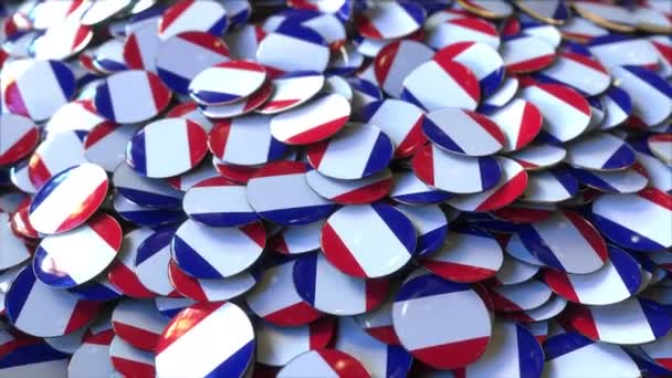 Pile of badges featuring flags of France