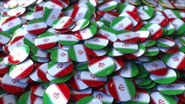 Pile of badges featuring flags of Iran