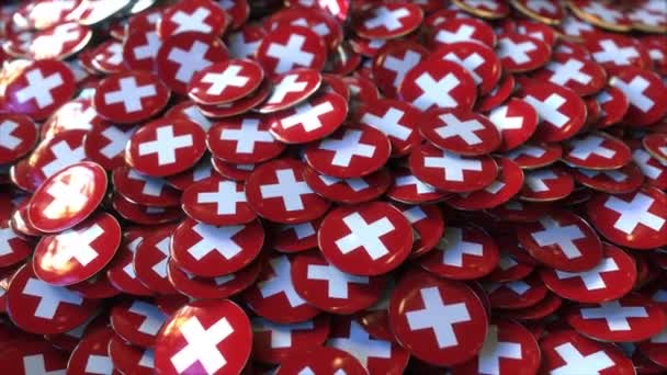 Pile of badges featuring flags of Switzerland