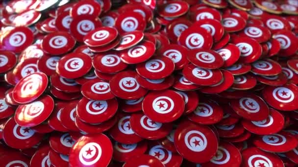 Pile of badges featuring flags of Tunisia