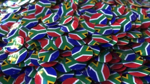 Pile of badges featuring flags of South Africa