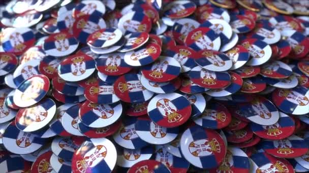 Pile of badges featuring flags of Serbia