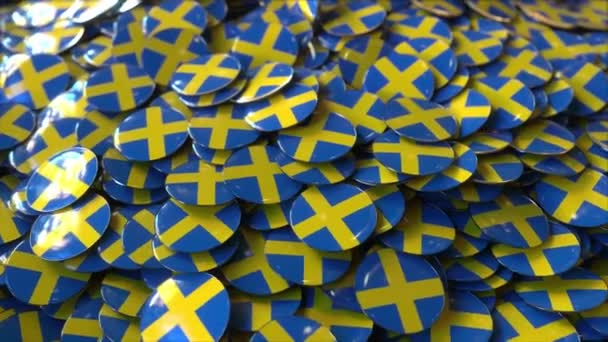 Pile of badges featuring flags of Sweden