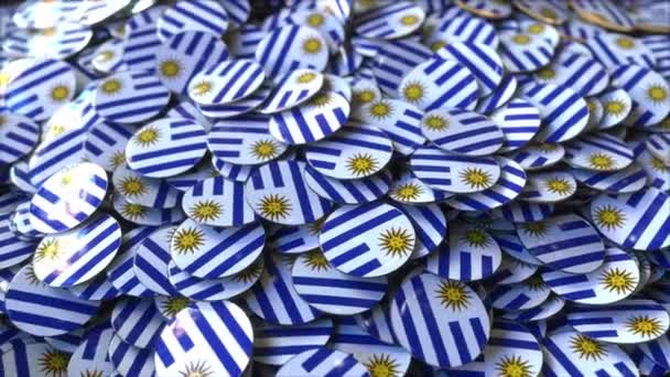 Pile of badges featuring flags of Uruguay