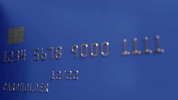 Rotating blue bank cards, loopable motion background