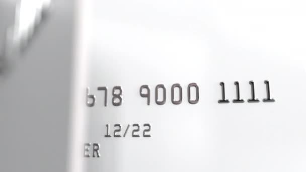 Rotating blank white bank cards, seamless loop