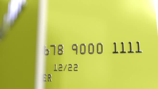 Turning yellow credit cards 3D animation, seamless loop