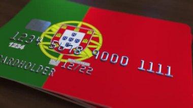 Műanyag bank kártya featuring a Portugália lobogója. Nemzeti bankrendszer kapcsolódó animáció