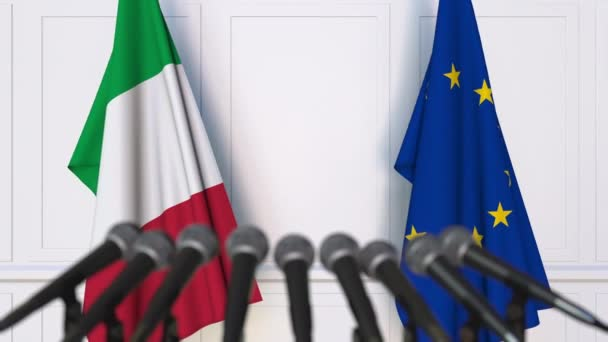 Flags of Italy and the European Union at international meeting or negotiations press conference