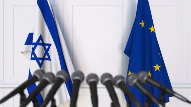 Flags of Israel and the European Union at international meeting or negotiations press conference