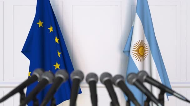 Flags of the European Union and Argentina at international meeting or negotiations press conference