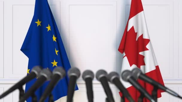 Flags of the European Union and Canada at international meeting or negotiations press conference