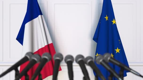 Flags of France and the European Union at international meeting or negotiations press conference