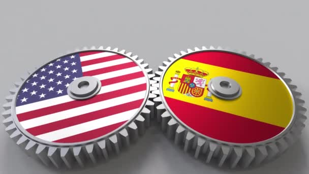 Flags of the USA and Spain on meshing gears. International cooperation conceptual animation