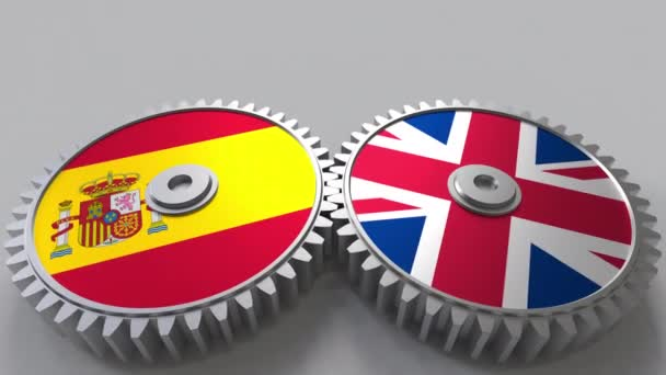 Flags of Spain and the United Kingdom on meshing gears. International cooperation conceptual animation