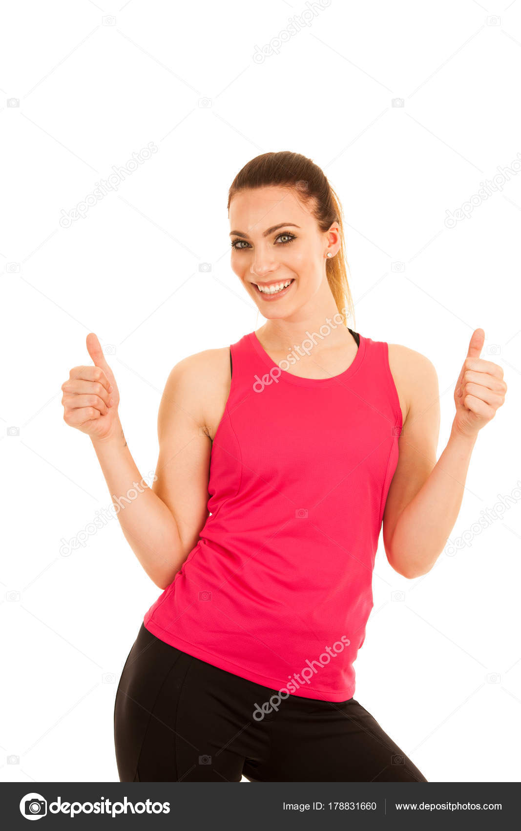 Beautifil Young Sporty Woman Shows Thumb Up As A Gesture Fo