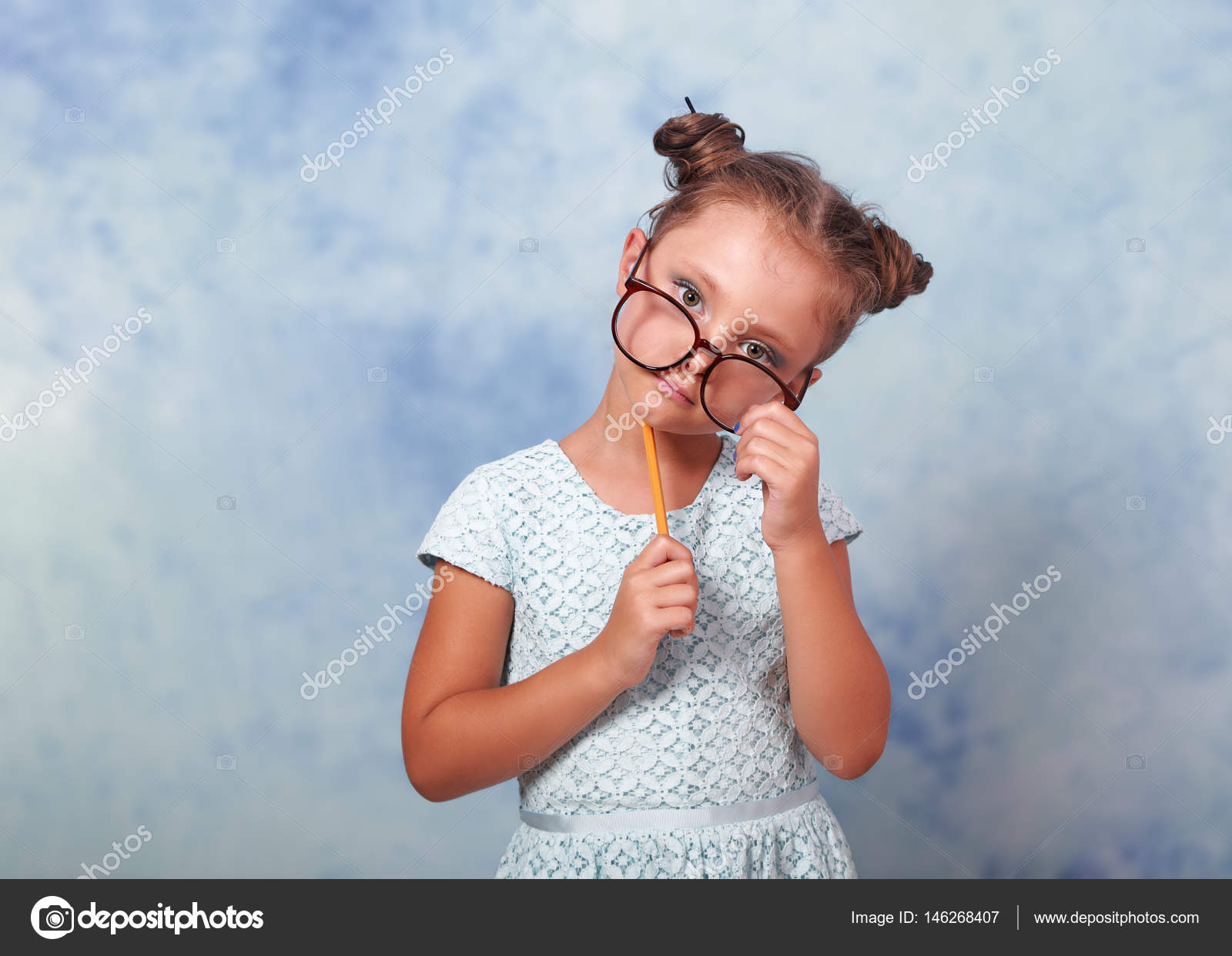 c42ba40203 Thinking fun kid girl in glasses looking happy and holding eyegl — Stock  Photo