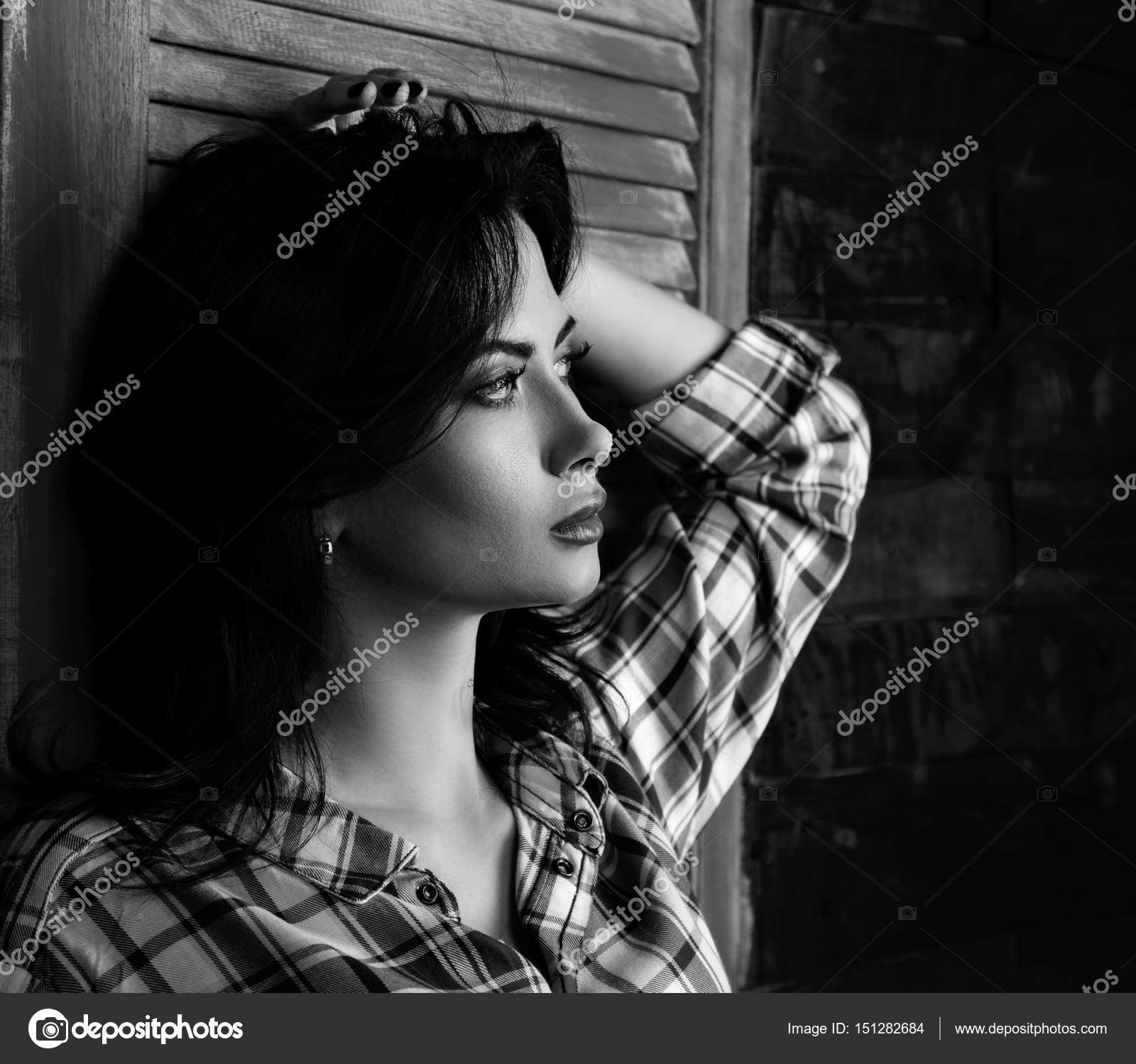 Pensive beautiful young woman profile in trendy black and white