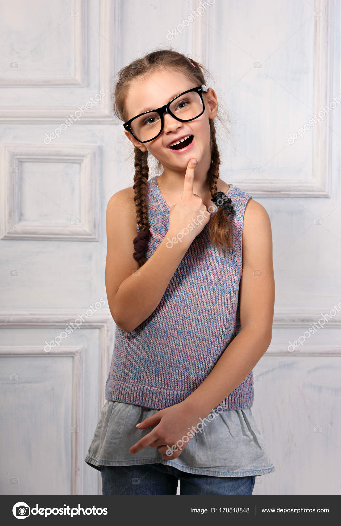 c2a8c46b16 Happy thinking kid girl in fashion glasses with excited emotiona — Stock  Photo