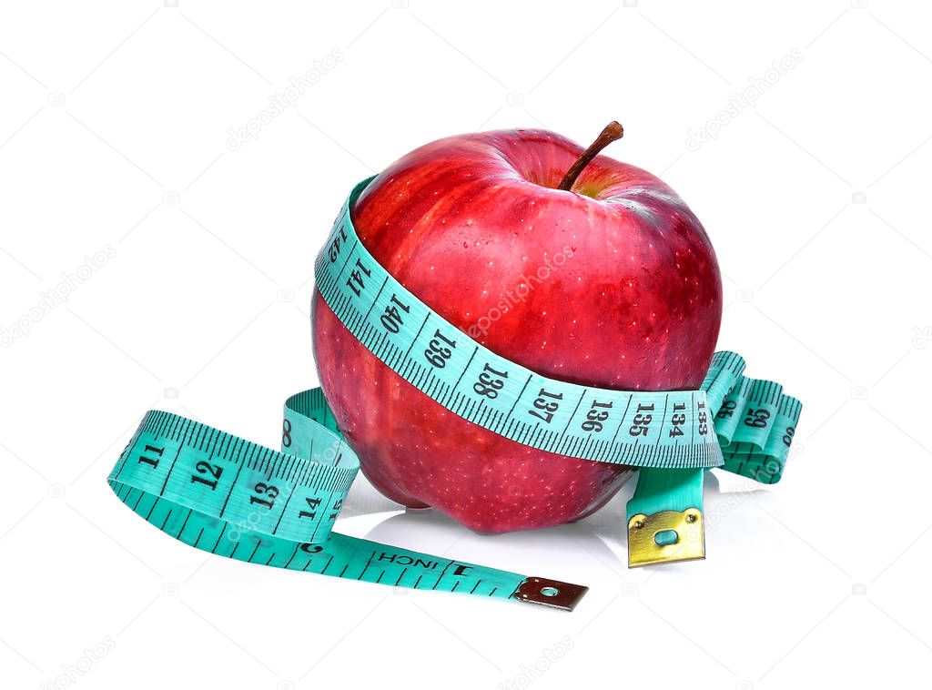 red apple with measuring tape isolated on white background