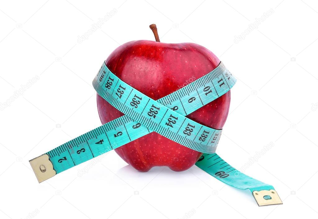 red apple with measuring tape isolated on white background,