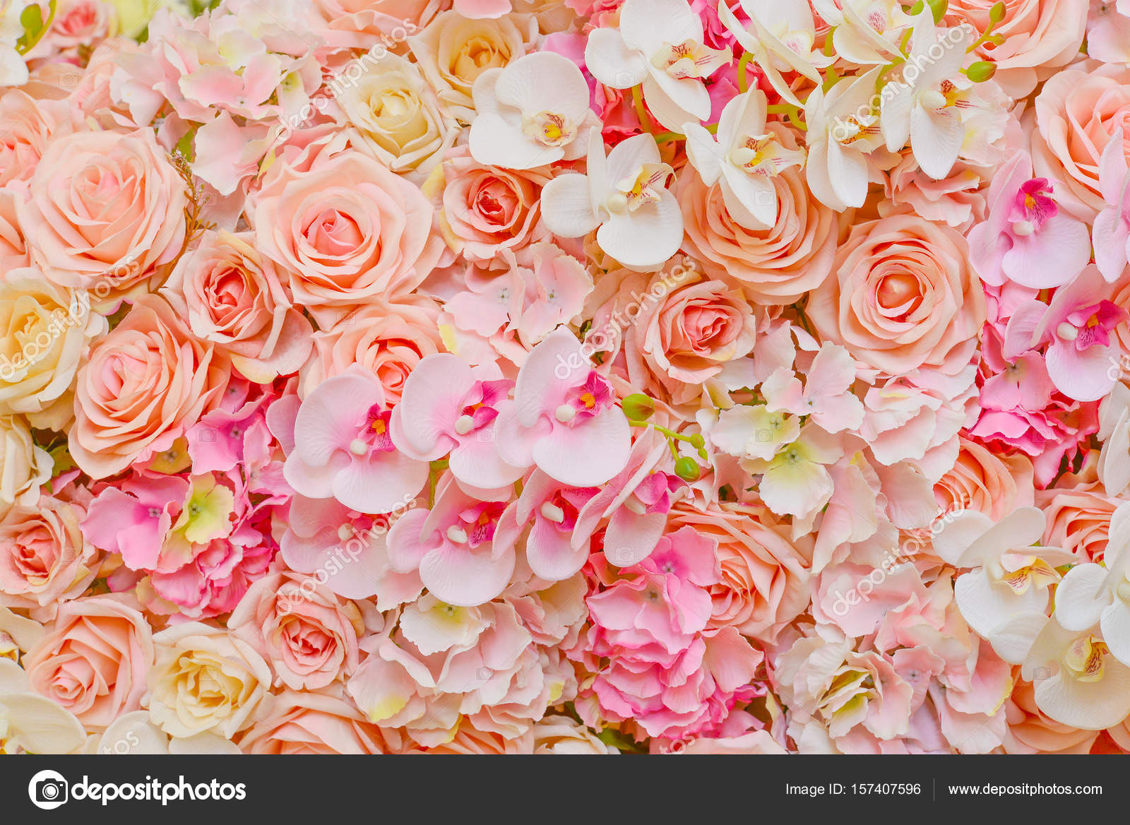 Fake flowers of beautiful pink roses and orchids for wedding dec fake flowers of beautiful pink roses and orchids for wedding dec stock photo 157407596 izmirmasajfo Choice Image