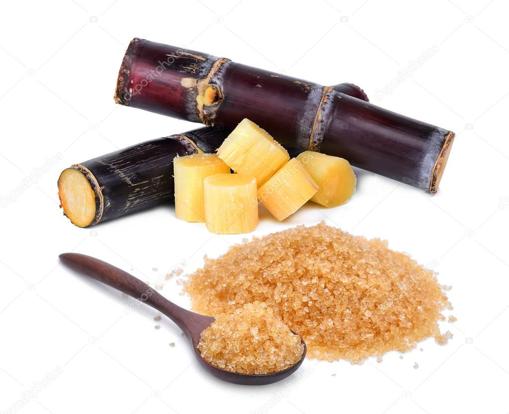 brown cane sugar in wooden spoon with fresh sugarcane isolated o