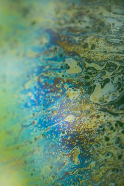 Soap bubble abstraction very close with movement and different colors