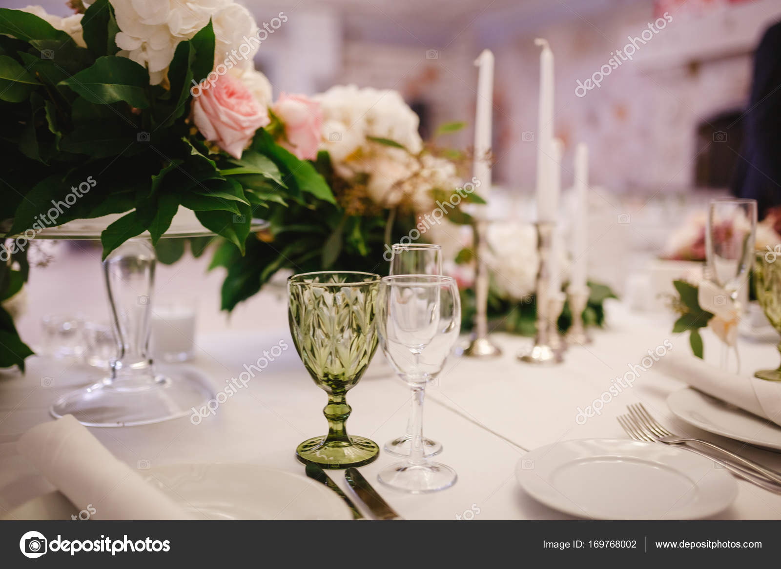 Table Decor With White Flowers And Candles For A Wedding Party