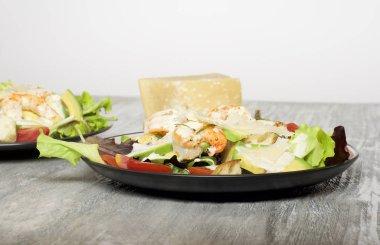 Caesar salad with prawns and avocado