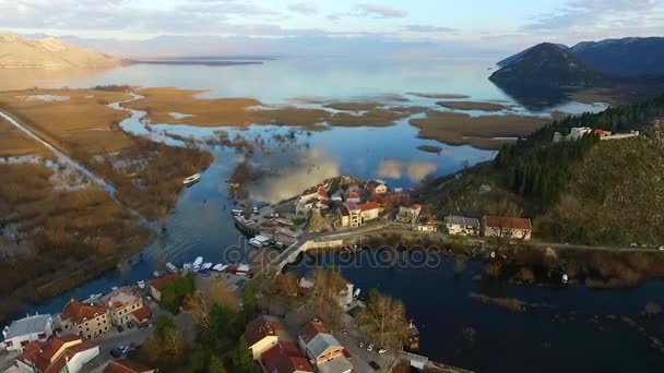 Flying over the lake and the old town Virpazar, Skadar Lake in Montenegro