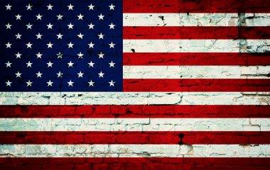 Flag on wall of bricks