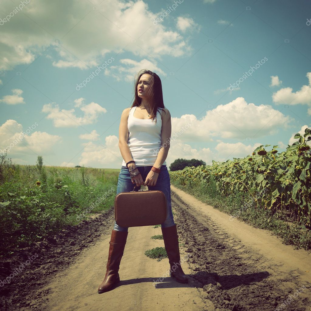 Young woman with retro suitcase