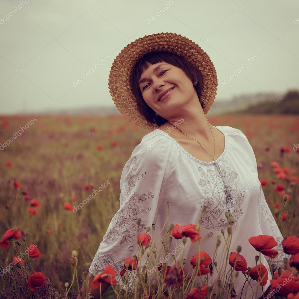 Cheerful woman in straw hat