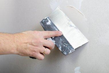 repairman works with plasterboard