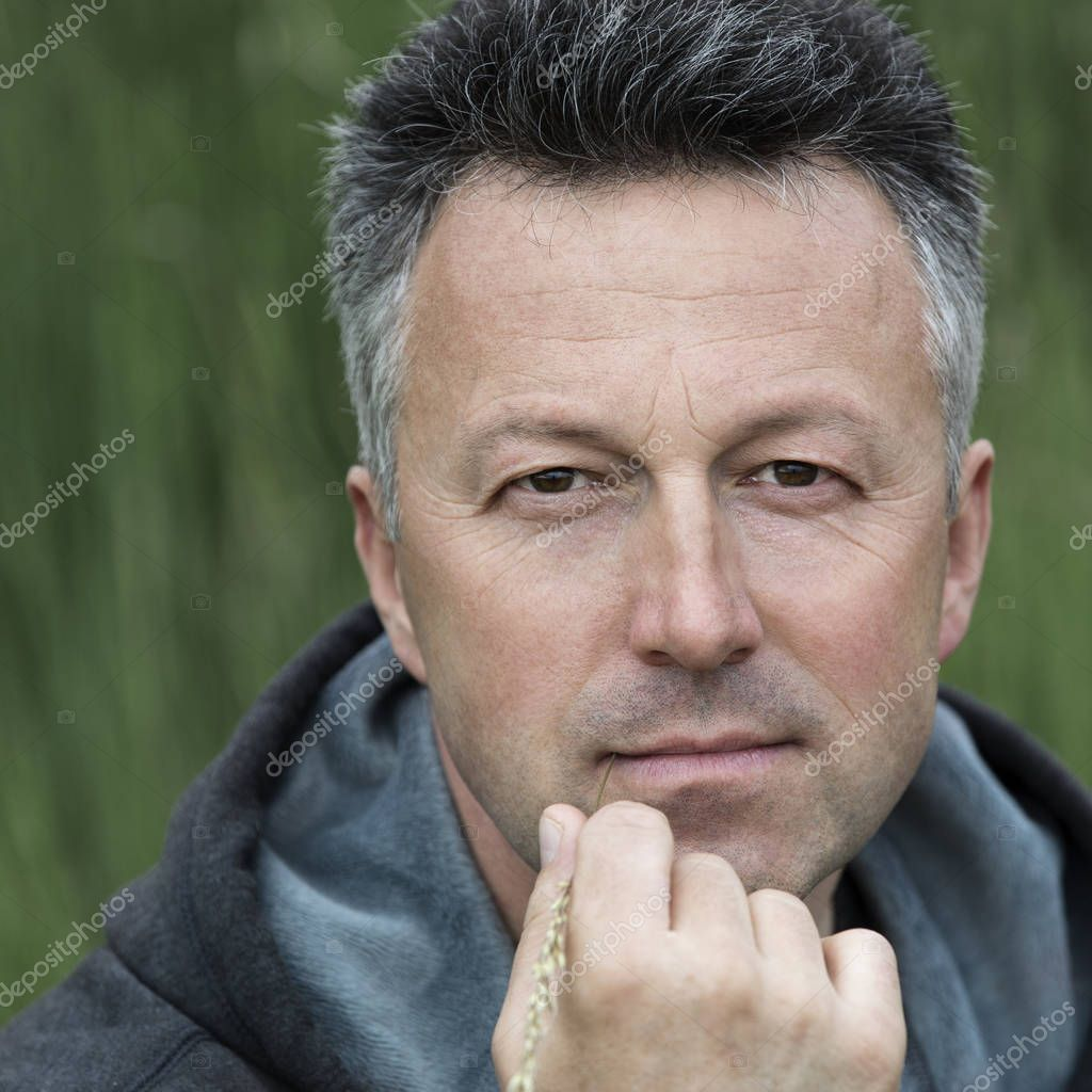 handsome middle-aged man on nature