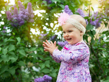 Beautiful little girl happy smiling and claps her hands over lil