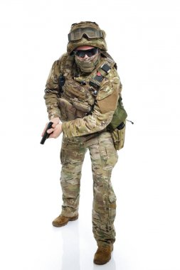Military man in camouflage uniform, armor vest, dark glasses and