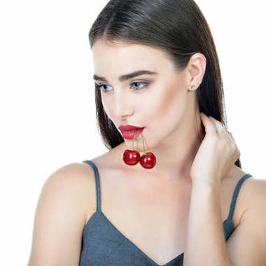 Young beautiful woman with ripe cherry. Beautiful woman with fre