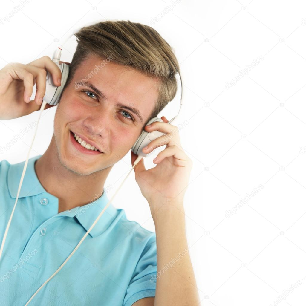 young man listening to music stock photo emiliau 125594006