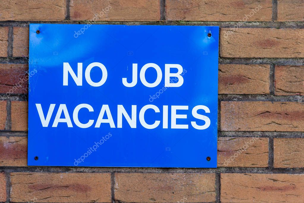 No Jobs Blue Advert Sign On Brick Wall