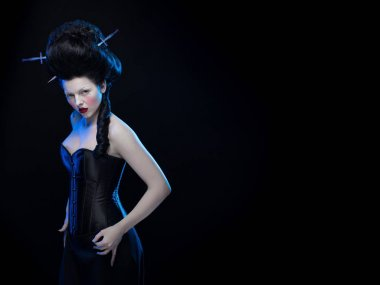 actress brunette woman with high hair and a corset in old style