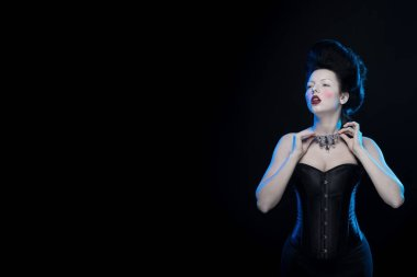 brunette woman with high hair, necklaces and corset in old style