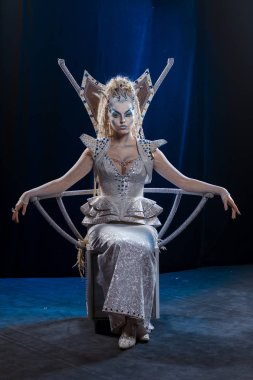emotional actress woman in makeup and costume of the Snow Queen