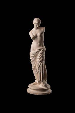 Venus statue on a black background