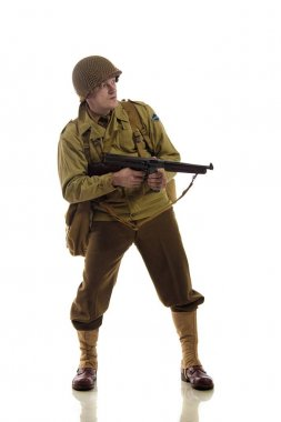 Man actor in military uniform of American ranger of World War II period posing against white background