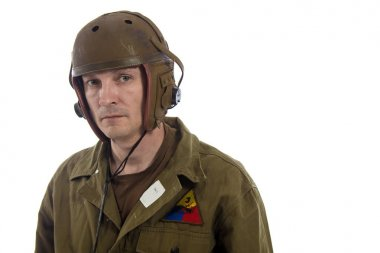 Man actor in military uniform of American tankman of World War II posing on white background