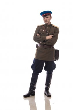 Man actor in the form of an officer captain People's Commissariat of Internal Affairs of Russia from the period 1943-1945 posing on a white background