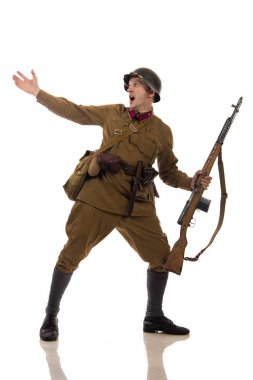 Male actor in the form of ordinary soldiers of the Russian army in the period 1939-1940, with aSelf-loading rifle Tokarev on a white background in the studio