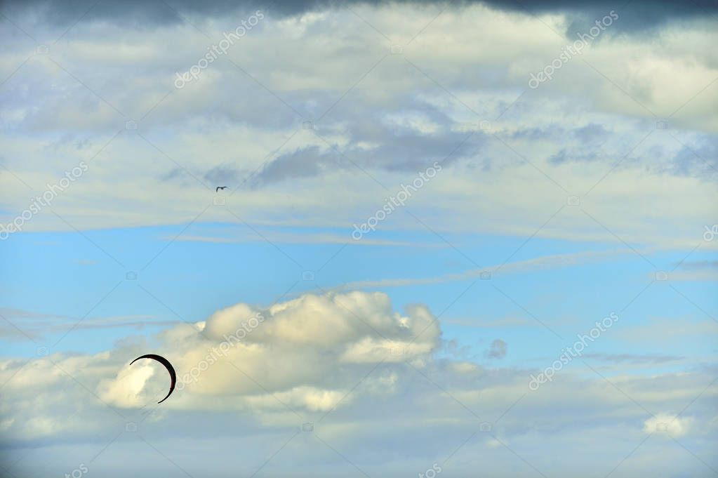 Kite surfing parachute in sky. Kite Boarding, Fun in the ocean, Extreme Sport